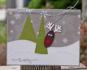 Reindeer behind tree card